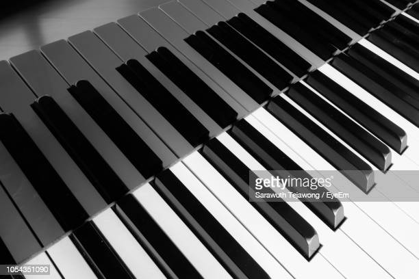 close-up of piano keys - piano key stock photos and pictures