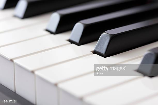 close-up of piano keys - electric piano stock photos and pictures