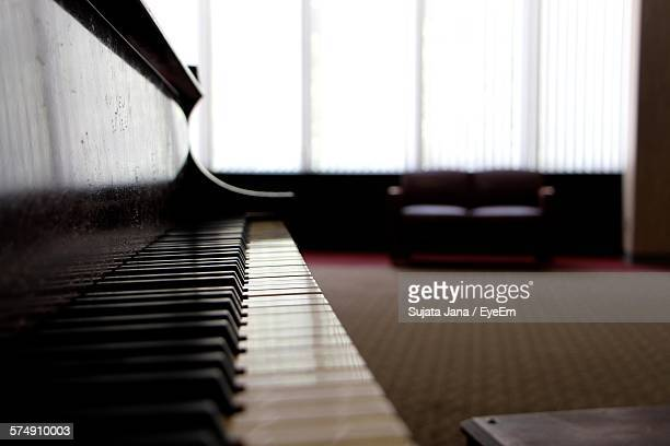 Close-Up Of Piano On Floor At Home
