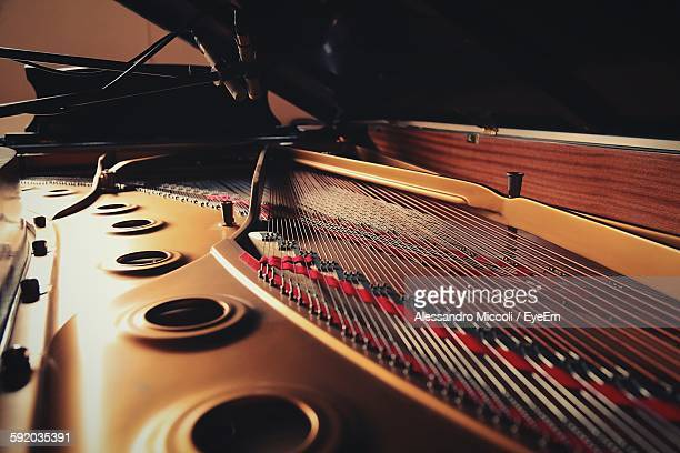 close-up of piano strings - grand piano stock photos and pictures