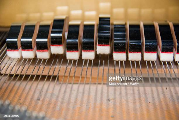 close-up of piano strings - string instrument stock photos and pictures