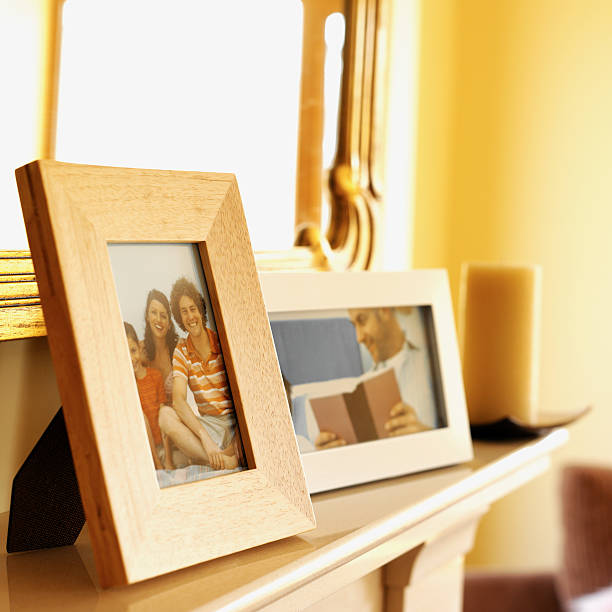 close-up of picture frames on a mantelpiece
