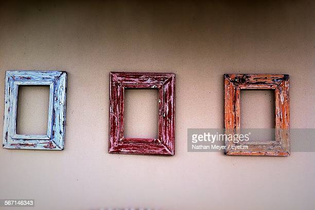 Close-Up Of Picture Frames On Wall
