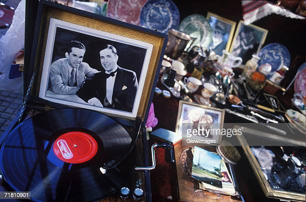 close-up of picture frames with crockery on a table - picture of phonograph stock photos and pictures