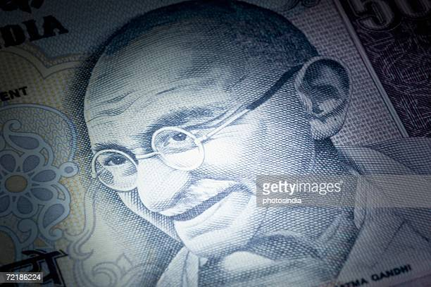 Close-up of picture of Mahatma Gandhi printed on an Indian one hundred rupee banknote