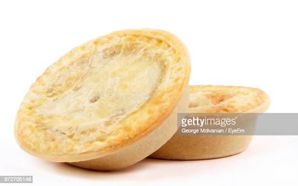 Close-Up Of Pie Against White Background