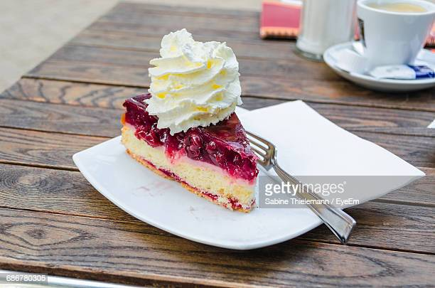 close-up of pie served on plate - dessert topping stock pictures, royalty-free photos & images