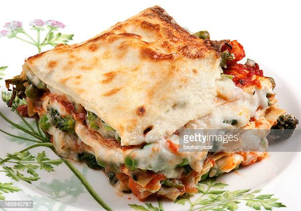 Closeup of piece of lasagna served on a white plate