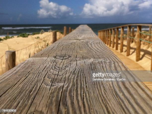 Close-Up Of Pier On Beach Against Sky