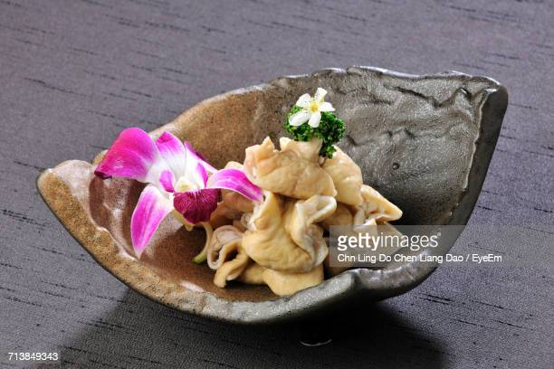 Close-Up Of Pig Intestines In Bowl Served On Table