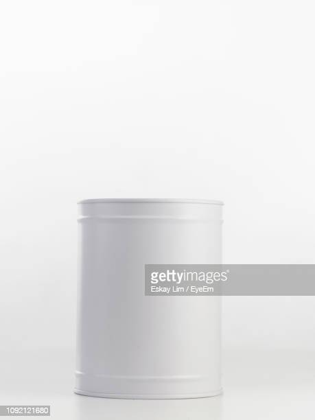 close-up of piggy bank against white background - cylinder stock pictures, royalty-free photos & images