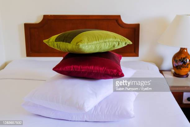 close-up of pillow on bed at home - pillow stock pictures, royalty-free photos & images