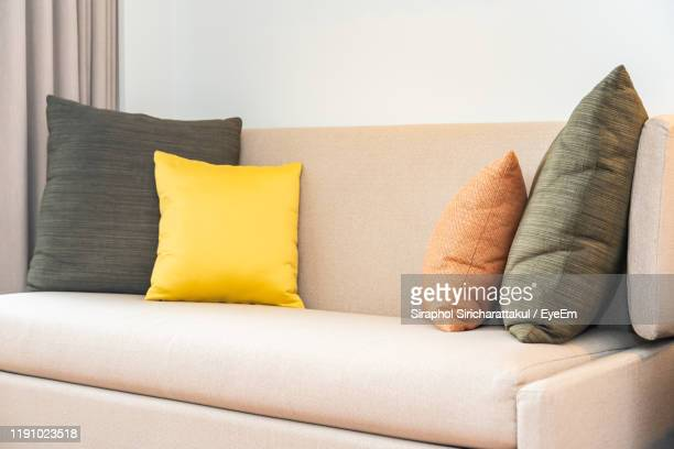close-up of pillow on sofa at home - pillow stock pictures, royalty-free photos & images