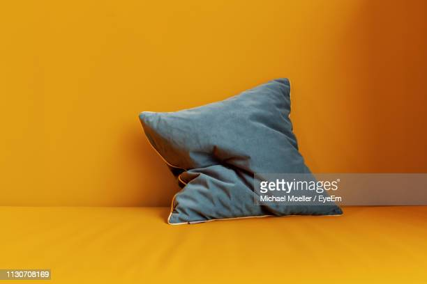 close-up of pillow on sofa - pillow stock pictures, royalty-free photos & images