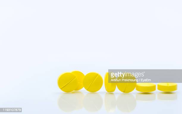 close-up of pills against white background - magnesium stock pictures, royalty-free photos & images
