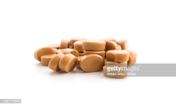 close-up of pills over white background - caramelo de manteiga comida doce imagens e fotografias de stock