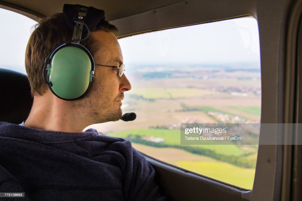 Close-Up Of Pilot Sitting In Airplane : Photo
