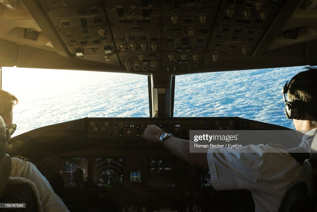 Close-Up Of Pilots In Cockpit : Stock Photo