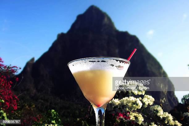 Close-Up Of Pina Colada In Glass Against Mountain