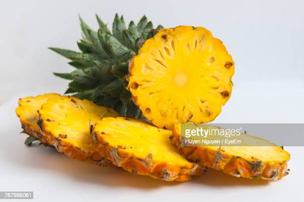 Close-Up Of Pineapple Slices Against White Background
