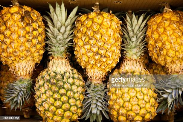 close-up of pineapples in market - okinawa prefecture stock pictures, royalty-free photos & images
