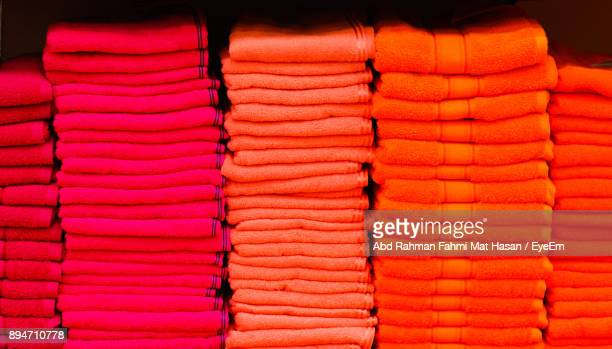Close-Up Of Pink And Red Towels For Sale At Market