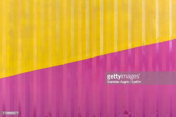 close-up of pink and yellow wall - corrugated iron stock photos and pictures