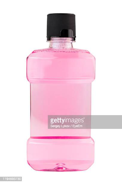 close-up of pink bottle against white background - mouthwash stock pictures, royalty-free photos & images