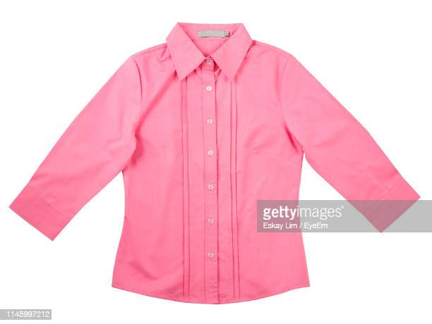 close-up of pink button down shirt against white background - down blouse stock pictures, royalty-free photos & images