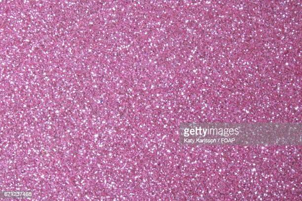 close-up of pink glitter. - pink sparkles stock pictures, royalty-free photos & images
