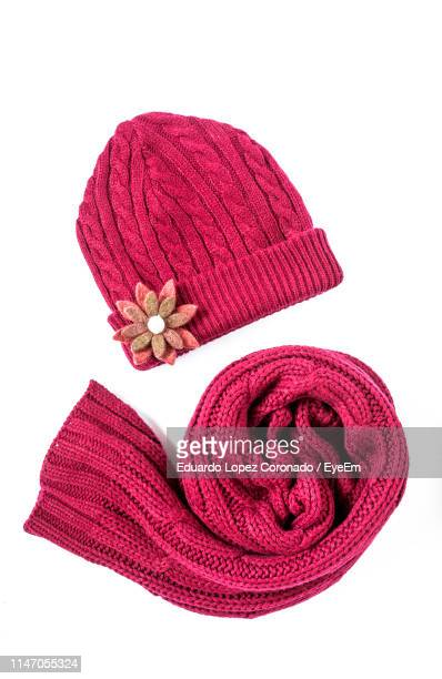 close-up of pink hat and scarf against white background - マフラー ストックフォトと画像