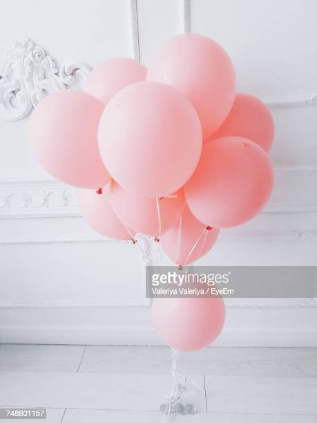 close-up of pink helium balloons - pink stock pictures, royalty-free photos & images