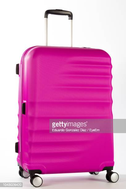 close-up of pink luggage over white background - suitcase stock pictures, royalty-free photos & images