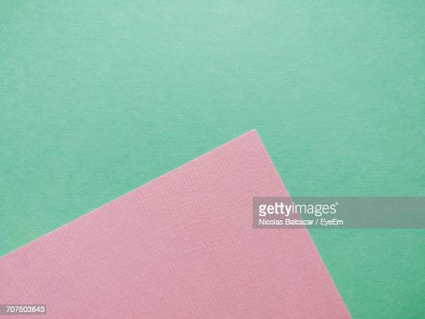 Close-Up Of Pink Over Green Background
