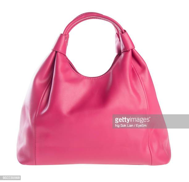 close-up of pink purse against white background - pink purse stock pictures, royalty-free photos & images