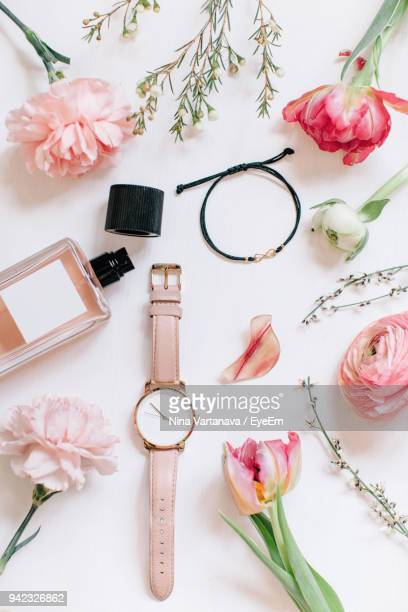 close-up of pink roses with accessories on table - 服飾品 ストックフォトと画像