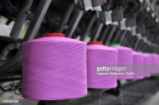 close-up of pink thread spools on machinery - cetkauskas stock pictures, royalty-free photos & images