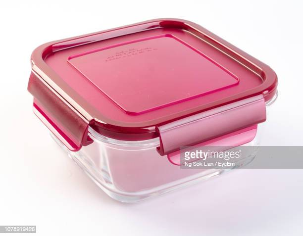 close-up of pink tiffin box on white background - tiffin box photos et images de collection