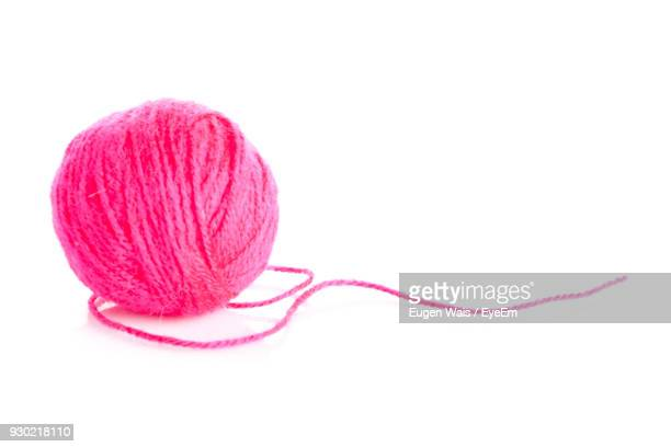 Close-Up Of Pink Wool Over White Background