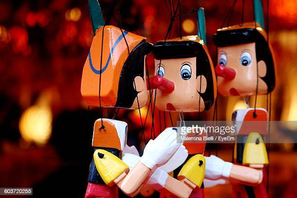 close-up of pinocchio puppets - pinocchio stock pictures, royalty-free photos & images