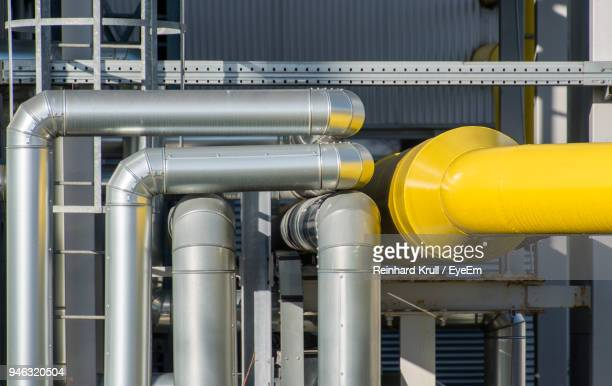 close-up of pipes in factory - oil refinery stock pictures, royalty-free photos & images