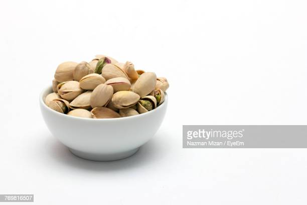 Close-Up Of Pistachio Against White Background