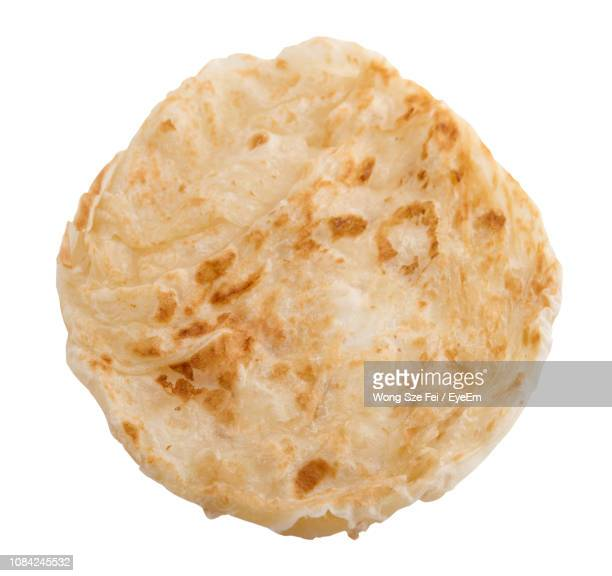Close-Up Of Pita Bread Over White Background