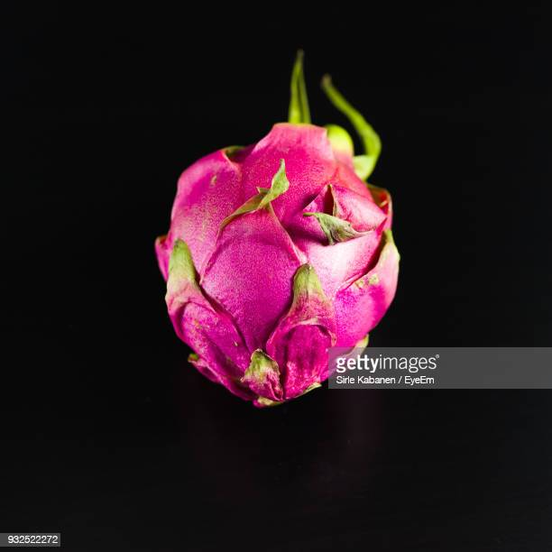 close-up of pitaya against black background - dragon fruit stock pictures, royalty-free photos & images