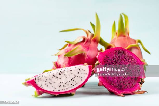 close-up of pitaya on table - dragon fruit stock pictures, royalty-free photos & images