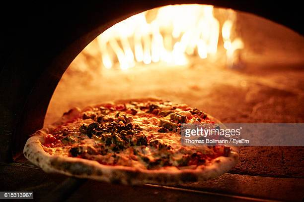 Close-Up Of Pizza By Oven