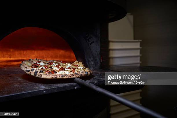 close-up of pizza by oven - pizza oven stock photos and pictures