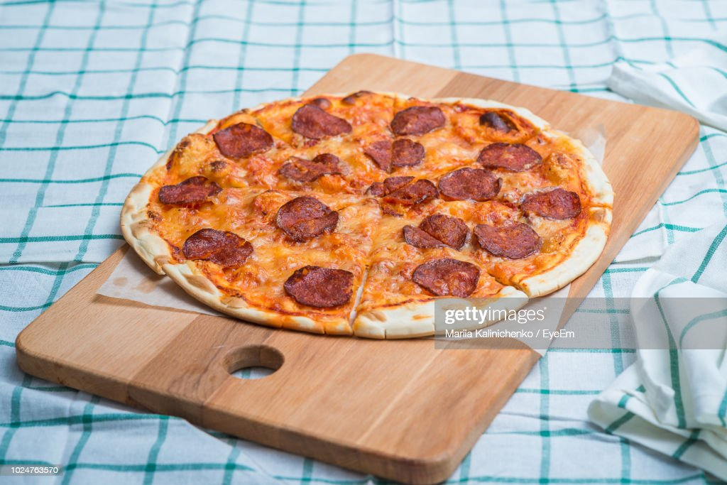 Close-Up Of Pizza On Cutting Board : Stock Photo