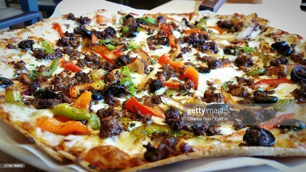 Close-Up Of Pizza On Table : Foto de stock