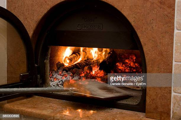 close-up of pizza oven - pizza oven stock photos and pictures
